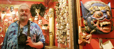 Ann Arbor professional photographer Mike Gould self-portrait in mask store in New Orleans
